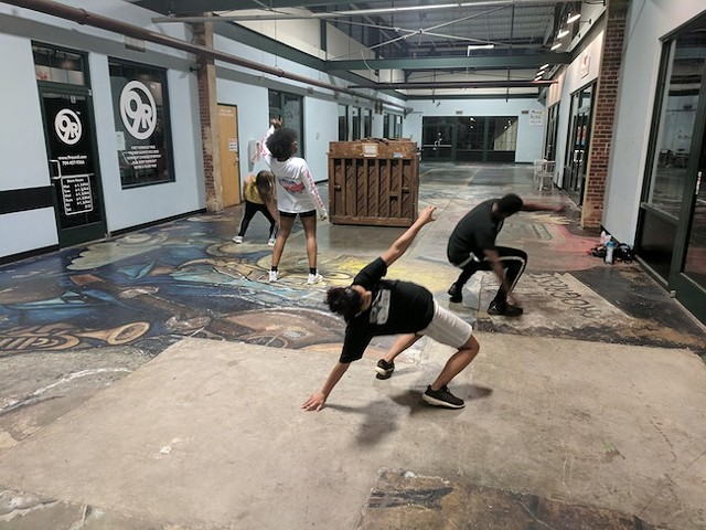Crayzee Collective dancers rehearse in the atrium of NoDa @ 28th. (Photo by Ryan Pitkin)