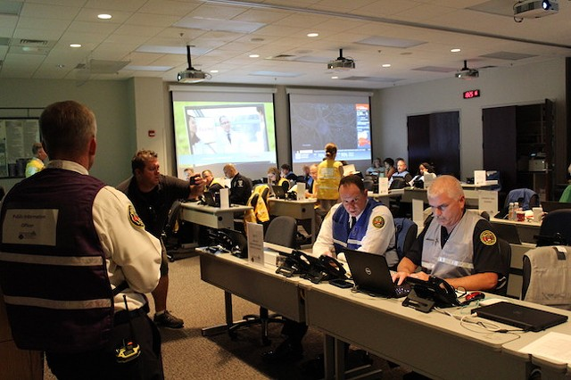 Robert Cannon (left) in the EOC as personnel work on storm preparations. (Photo by Courtney Mihocik)