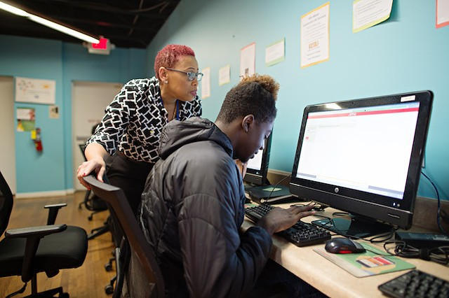 Resource coordinator Genine Donovan helps a client in the On Ramp upstairs resource center. (Photo by The Beautiful Mess)