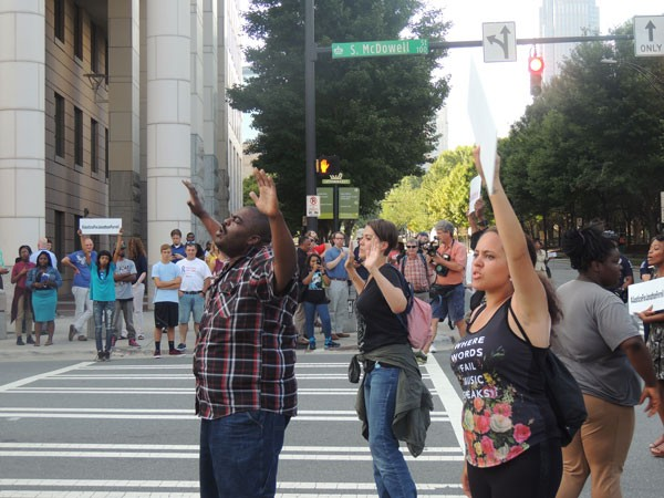 Protesters shut down the intersection of 4th and McDowell Streets following the announcement of a mistrial in the trial of Randall Kerrick on Friday, August 21.