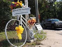 """A """"ghost bike"""" was placed at the scene of a crash that took the life of cyclist Al Gorman to memorialize him. (Photo by Ryan Pitkin)"""