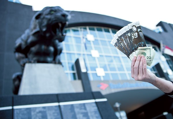 With the playoffs in town, ticket sales can be big business outside of Bank of America Stadium. (Photo by Jeff Hahne)