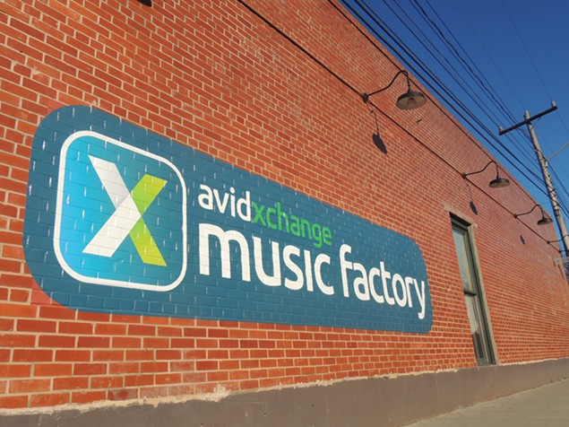 The logo, as painted on the side of Small Bar, for the newly-named AvidXchange Music Factory. - RYAN PITKIN