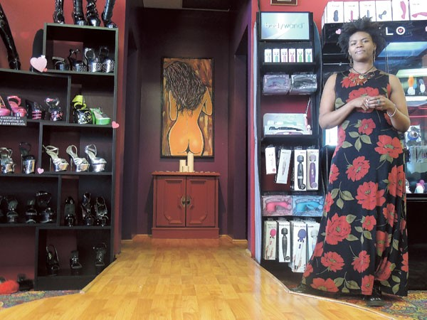 Brianna Daniels, a RedDoor sales associate, stands by some of the store's displays. (Photo by Ryan Pitkin)