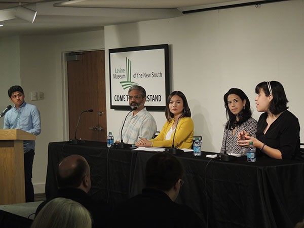 """Panel at Levine Museum of the New South's event """"Which Way Home: Refugees in Charlotte."""" - RYAN PITKIN"""