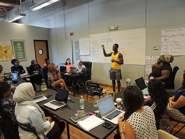Bokar Diaby addresses fellow students partipating in a fellowship with the Students for Education Reform Action Network this summer. (Photo by Ryan Pitkin)