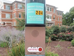 Intercoms that call directly to campus police dot the walking paths on UNC Charlotte's campus. - RYAN PITKIN
