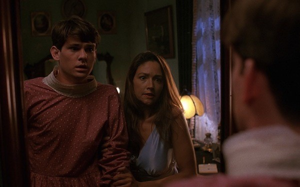 Henry Thomas and Olivia Hussey in Psycho IV: The Beginning (Photo: Shout! Factory)