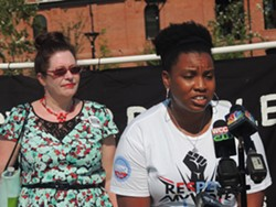 """Nakisa Glover with the Hip Hop Caucus expressed her support for the """"People, Not Polluters"""" platform. - RYAN PITKIN"""