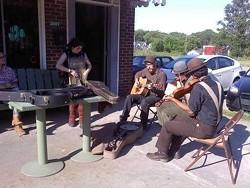 An impromptu jam session outside Tommy's Pub.