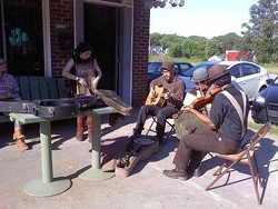 An impromptu jam session outside Tommy's Pub.