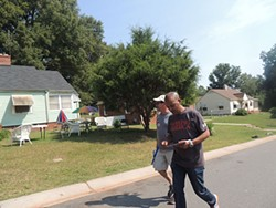 Tefere Gebre, executive director with the national AFL-CIO canvasses in the Charlotte's Wilmore neighborhood with Jerry Hodge of UAW Local 3520 in Cleveland, North Carolina. - RYAN PITKIN