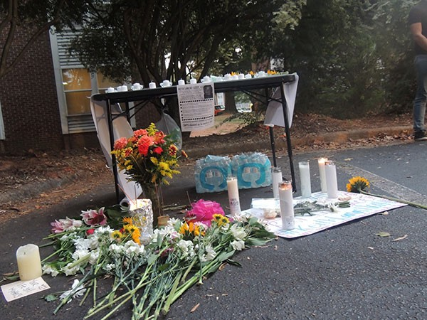 A memorial to Keith Lamont Scott in the parking lot where he was killed. - RYAN PITKIN