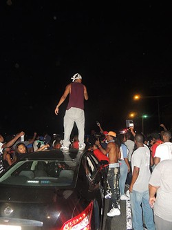 Jamil Gill hopped on top of his car and began filming police on Tuesday night. His Facebook Live feed would later garner over 60,000 viewers. - RYAN PITKIN