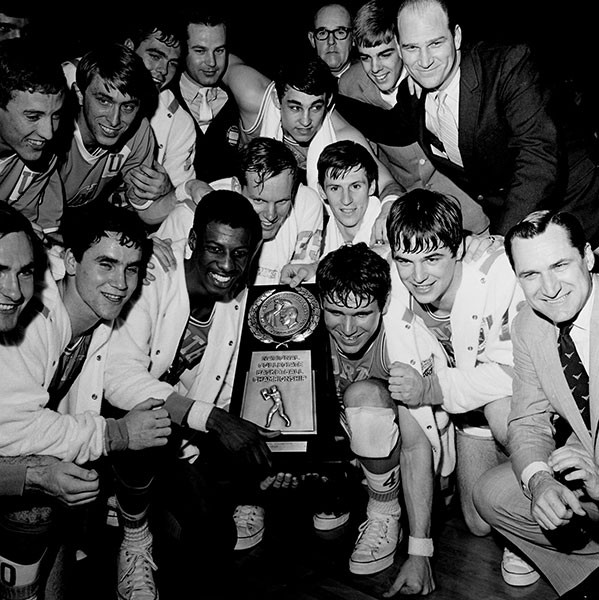 The team poses with the 1968 NCAA Regional Trophy. - HUGH MORTON