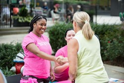 Planned Parenthood staff speaking with a resident at a recent event.