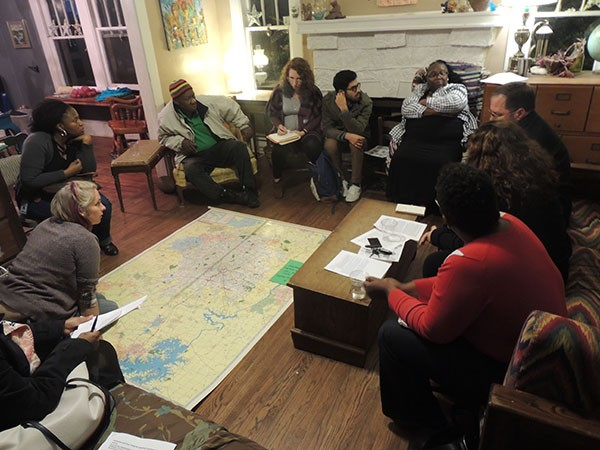 Organizers with the West Side Land Trust (working title) discuss which neighborhoods should be included in the trust at a recent meeting. - RYAN PITKIN