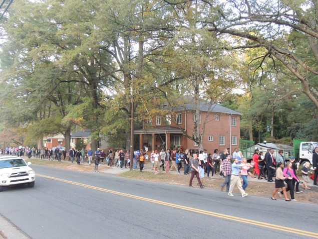 """The """"March to the Polls"""" on Parkway Avenue in west Charlotte. - RYAN PITKIN"""