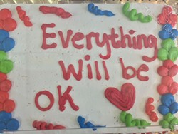 A cake awaits students from Oakhurst Elementary School at ourBRIDGE for Kids, an afterschool program for immigrant and refugee students, on the day following the election of Donald Trump. - RYAN PITKIN