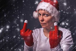 beautiful-woman-in-santa-claus-costume-giving-middle-finger-.jpg