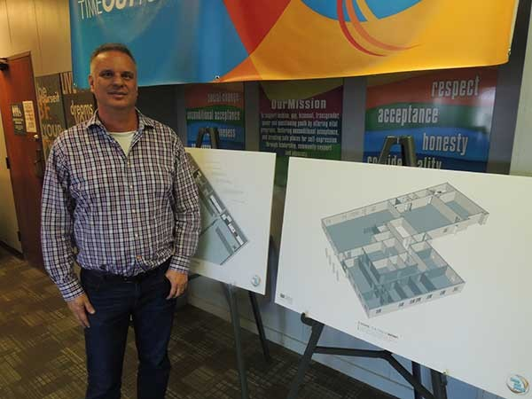 Rodney Tucker with sketch plans for the new TOY space on Monroe Road.