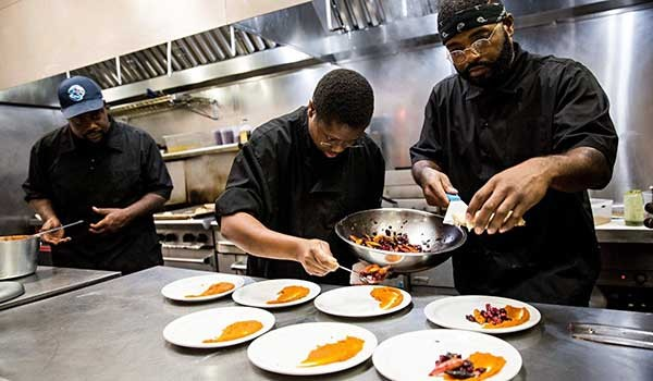 Mike Bowling (from left), Sam Dotse and Greg Williams prepare delicious sweet potato-watermelon molasses puree and vegetable hash. - PHOTO BY PETER TAYLOR