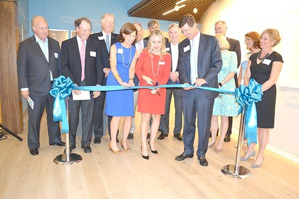 Betsy and Bill Blue (both holding ribbon) at the grand opening of Hopeway Foundation, a step-down facility for those discharged from acute mental health treatment. Alyson R. Kuroski-Mazzei (cutting the ribbon) is HopeWay's clinical director. - LOUISE BONNER