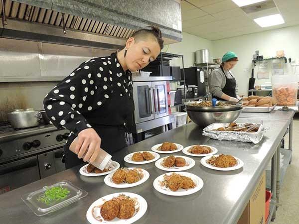 Julia Simon in the kitchen at Nourish Charlotte.
