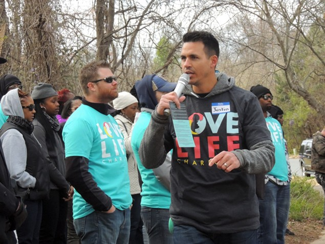 Justin Reeder of Love Life Charlotte speaks to church members standing in front of PWHC. - RYAN PITKIN