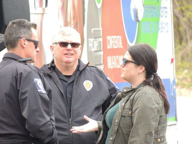 Calla Hales speaks with police about enforcing ordinances at a recent protest.