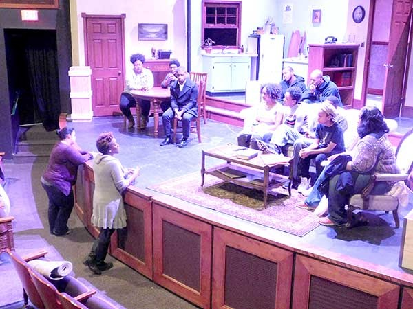 Kim Parati, lower left, addresses cast of A Raisin in the Sun after rehearsal. - BEN SPARENBERG