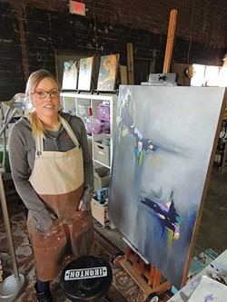 Angela Clousher is a painter at C3 Lab. - PHOTO BY RYAN PITKIN