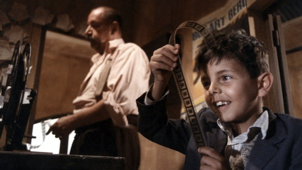 Phillipe Noiret (background) and Salvaore Cascio in Cinema Paradiso (Photo: Arrow)