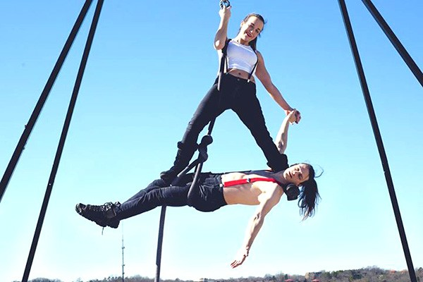 "Rachel MacNab (top) and Linus Matusik strike a pose. - PHOTO BY MUHSAIN ""MOOSE"" COPPER"