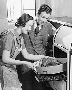 couple-in-kitchen_-wife-taking-roast-from-oven-_b_w_-72131201_2818x3534.jpg