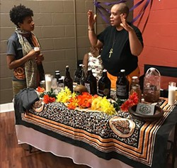 Danielle Hilton and L.A. McRae (right) talk at a recent tasting in Charlotte.