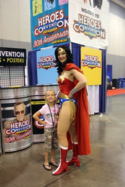 Wonder Woman poses with a young fan.
