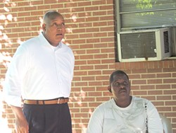 Reginald Howard speaks to N.C. Sen. Joel Ford at a recent gathering at Twin Oaks to discuss the sale of the property.