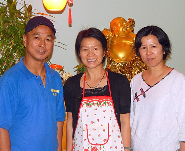 Chef Fang Xian Chen (left) with owner Jian Chen (center; no relation) and her sister. (Photo by Catherine Brown)
