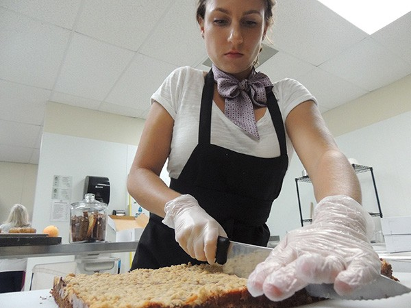 Janceviciute at work in her kitchen off Monroe Road. (Photo by Ryan Pitkin)