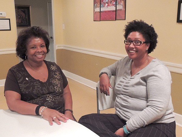 Linda Hill [left] and Jasmine Hines hang out after class. (Photo by Ryan Pitkin)