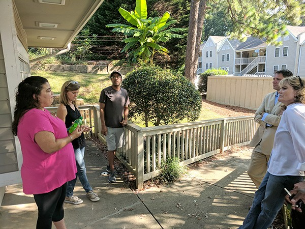 Brittany Woods residents Tanya Burns [far left] and Troy Graham [middle] discuss options with concerned neighbors [from left] Molly Barker, Robert Forquer and Allyson Siegle. (Photo by Ryan Pitkin)