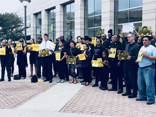 Community members gathered to demand answers after body cam footage showed Ruben Galindo's arms were up when he was killed by CMPD officers on Sept. 6. (Photo by amalia deloney)
