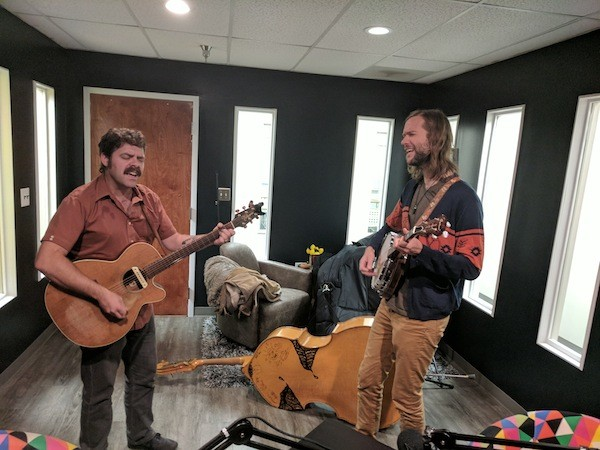"""Perry Fowler [left] and Mark Baran of Sinners & Saints play """"Mama"""" in the Hygge West podcast studio."""