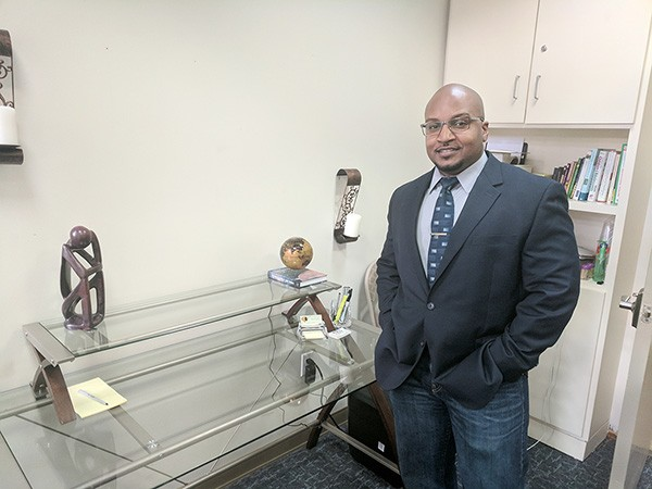 Kareem Puranda in his Charlotte office, where he meets in groups and one-on-one with police officers to deal with potential psychological issues. (Photo by Ryan Pitkin)