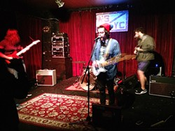 Brett Green and the Mineral Girls on stage in Cincinatti. (Photo by Josh Dawson)