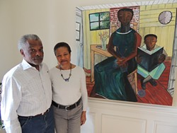 The Diamonds in their home with art by Nellie Ashford. (Photo by Ryan Pitkin)