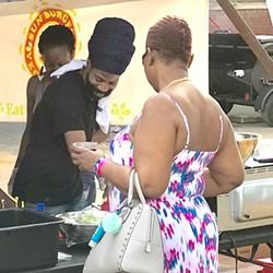 Stephens (in black turban) prepares ital cuisine at the Bla/Alt Fest.