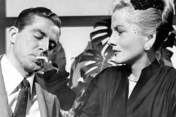 Dana Andrews and Joan Fontaine in Beyond a Reasonable Doubt (Photo: Warner)
