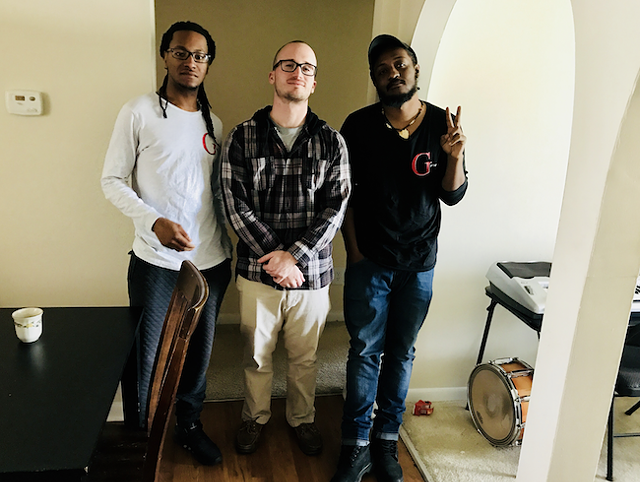 Brown (right) with Gifted partners Walter Boston III (far left) and John Alex Harper at Boston's SouthPark apartment. (Photo by Mark Kemp)